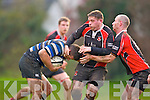 John O'Sullivan and Ger Allman Killarney holds up the Castlehaven forward during their game in Killarney on Saturday
