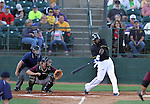 SIOUX FALLS, SD - AUGUST 2:  Reggie Abercrombie #1 from the Sioux Falls Canaries rips a base hit in the first inning as catcher Petey Paramore #25 from the Kansas City T-Bones defends Friday night at the Sioux Falls Stadium. (Photo by Dave Eggen/Inertia)