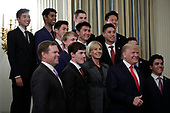 United States President Donald J. Trump and US Secretary of Education Betsy DeVos pose with athletes from the Stanford University Men's Golf as part of NCAA Collegiate National Champions Day at the White House in Washington on November 22, 2019. <br /> Credit: Yuri Gripas / Pool via CNP