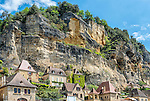 The cliffs of the village of La Roque-Gageac, viewed from a Gabares Norbert boat on the Dordogne.