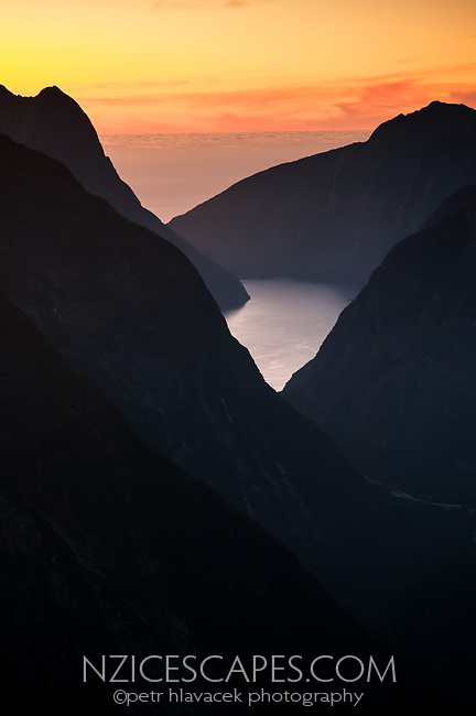 Dusk over Milford Sound as seen from Gertrude Saddle with Tasman Sea on horizon, Fiordland NP, Southland, World Heritage Area, New Zealand