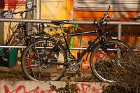 Double padlocked bike outside school. Hamburg, Germany.