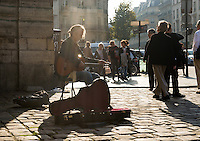 Stephen Lyman, musician, playing the Bach Lute Suites in front of the Eglise Saint-Germain des Prés beside Rue Bonaparte, Paris. Tuesday 23rd October 2012.