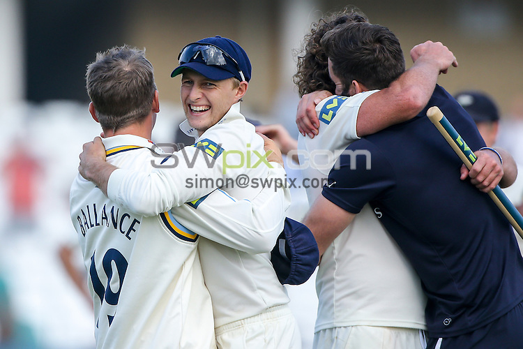 Picture by Alex Whitehead/SWpix.com - 12/09/2014 - Cricket - LV County Championship Div One - Nottinghamshire CCC v Yorkshire CCC, Day 4 - Trent Bridge, Nottingham, England - Yorkshire's stand-in captain Joe Root (second left) celebrates with Gary Balance (left).