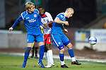 St Johnstone v Inverness Caley Thistle....02.01.11  .Eric Odhiambo is sandwiched between liam Craig and Danny Grainger.Picture by Graeme Hart..Copyright Perthshire Picture Agency.Tel: 01738 623350  Mobile: 07990 594431