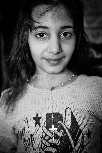 25..3.2015  Kirkuk,Iraq: Marta showing the cross while she is at home. She hides is under the shirt every time she leaves her house.