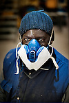 strange fruits is a work about immigration problems in Italy. Like the song of Billie Holyday wants to focus on problems derived from mixing different cultures. In this picture Ibrahim(Senegal)  portraited wearing a mask  in his garage in Sassari
