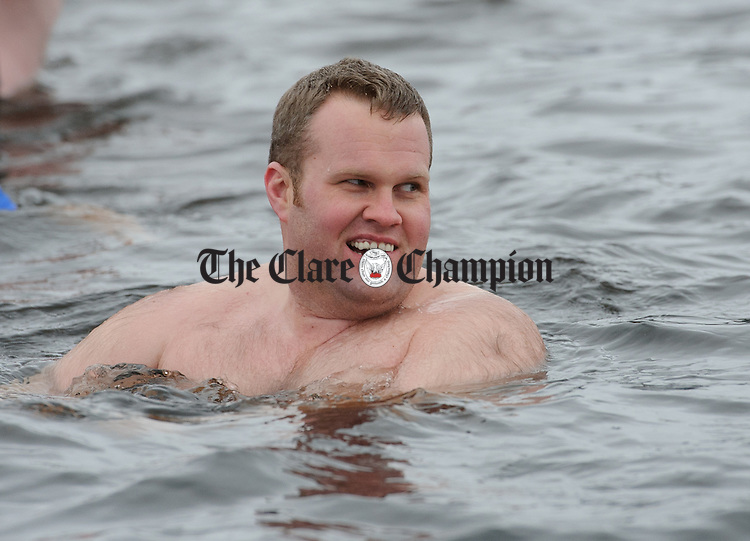Eoin O Connell enjoying a dip during the annual Christmas day swim at Gortglas  Lake, Kildysart in aid of the West Clare Mini Marathon Cancer fund. Photograph by John Kelly.