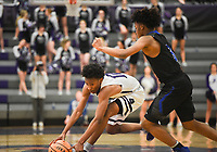 Fayetteville guard Corey Williams, Jr (12) picks up a loose ball during a basketball game, Friday, January 10, 2020 at Fayetteville High School in Fayetteville. Check out nwaonline.com/200111Daily/ for today's photo gallery.<br /> (NWA Democrat-Gazette/Charlie Kaijo)