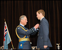 BNPS.co.uk (01202 558833)<br /> Pic: CrownCopyright/AirHistoricalBranch<br /> <br /> Prince William receives his wings from his father Prince Charles at RAF Cranwell in 2008.<br /> <br /> A new book gives an intimate look behind the scenes of the Royal Flight and also the flying Royals.<br /> <br /> Starting in 1917 the book charts in pictures the 100 year evolution of first the King's Flight and then later the Queen's Flight as well as the Royal families passion for aviation.<br /> <br /> Author Keith Wilson has had unprecedented access to the Queen's Flight Archives to provide a fascinating insight into both Royal and aeronautical history.