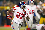 New York Giants running back Brandon Jacobs (27) scores a rushing touchdown to seal the game during an NFL divisional playoff football game against the Green Bay Packers on January 15, 2012 in Green Bay, Wisconsin. The Giants won 37-20. (AP Photo/David Stluka)