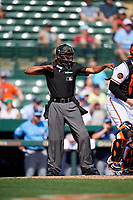 Home plate umpire Ramon De Jesus calls a batter out on strikes during a Grapefruit League Spring Training game between the Tampa Bay Rays and the Baltimore Orioles on March 1, 2019 at Ed Smith Stadium in Sarasota, Florida.  Rays defeated the Orioles 10-5.  (Mike Janes/Four Seam Images)
