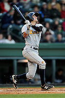 Shortstop Tyler Wade (7) of the Charleston RiverDogs bats in a game against the Greenville Drive on Wednesday, April 16, 2014, at Fluor Field at the West End in Greenville, South Carolina. Charleston won, 8-7. (Tom Priddy/Four Seam Images)
