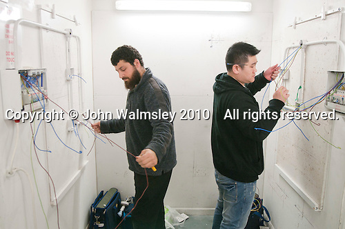Student electricians installing wiring, Able Skills, Dartford, Kent.
