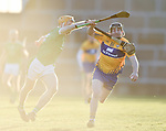 Richie English of  Limerick in action against Mikey O Neill of  Clare during their NHL quarter final at the Gaelic Grounds. Photograph by John Kelly.