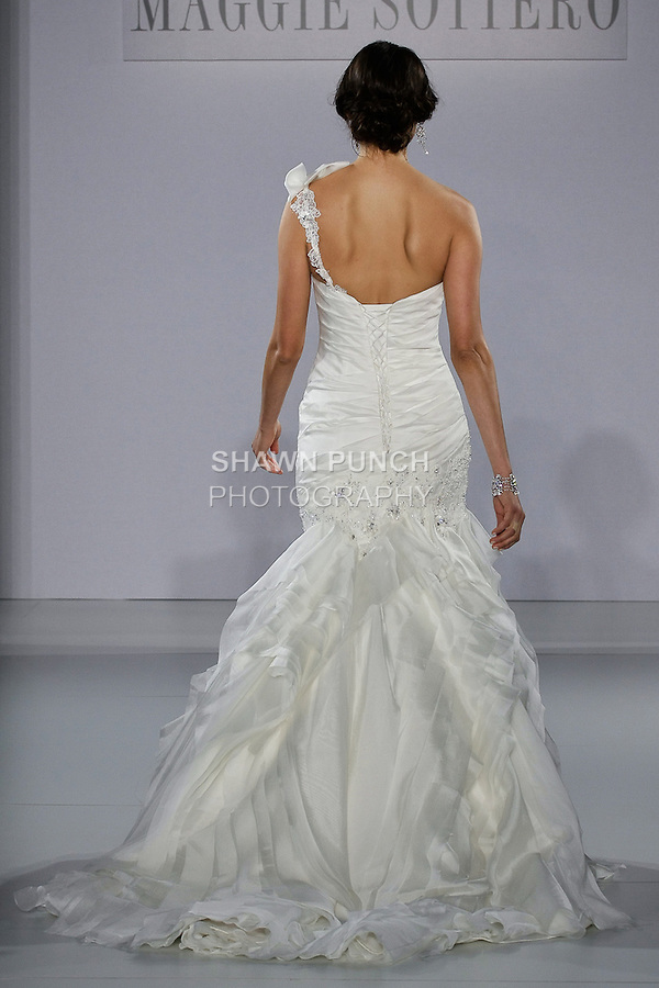 Model walks runway in an Ashlyn Rose wedding dress from the Sottero and Midgley Spring 2013 collection, at The Couture Show, during New York Bridal Fashion Week, on October 14, 2012.