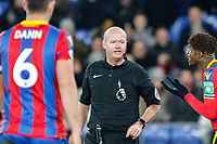 Wilfried Zaha of Crystal Palace complains to Referee Lee Mason during the Premier League match between Crystal Palace and Watford at Selhurst Park, London, England on 12 December 2017. Photo by Carlton Myrie / PRiME Media Images.