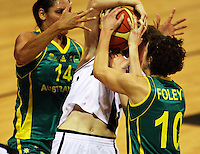 Opals forward Rohanee Cox and guard Jessica Foley try to wrestle the ball off Toni Edmondson during the International women's basketball match between NZ Tall Ferns and Australian Opals at Te Rauparaha Stadium, Porirua, Wellington, New Zealand on Monday 31 August 2009. Photo: Dave Lintott / lintottphoto.co.nz
