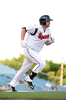 Nashville Sounds first baseman Hunter Morris (25) runs to first during the first game of a double header against the Omaha Storm Chasers on May 21, 2014 at Herschel Greer Stadium in Nashville, Tennessee.  Nashville defeated Omaha 5-4.  (Mike Janes/Four Seam Images)