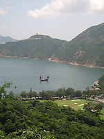 A Chinese junk sails around Hong Kong Island, near Stanley Market