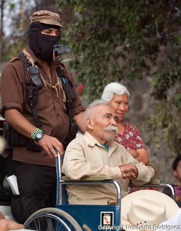 Zapatista struggler Felix Serdan addresses a speech after being welcomed by Subcommander Marcos as they protest against the destruction of an ecosystem in a ravine of Cuernavaca city in the southern state of Morelos, April 10, 2006. Enviromentalists and members of The Other Campaign, along with the Delegado Zero, the Zapatista leader Subcommander Marcos, joined to the struggle and defend the ecosystem, where the state government tries to construct an avenue. Photo by Heriberto Rodriguez