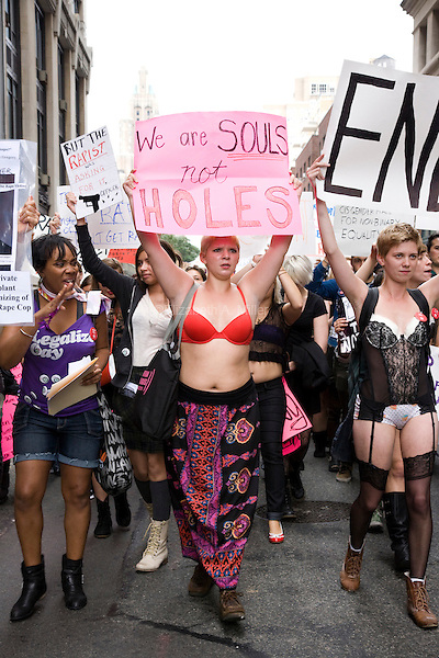 People participate in the SlutWalk NYC March and Rally on 01 October 2011 in New York City, New York.  The movement is an effort to end rape culture, aligning itself with diverse communities, activists, and survivors who live with and fight the effects of rape.