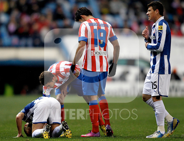 Atletico de Madrid's Koke, Diego Costa (r) and Espanyol's H.Moreno during La Liga  match. February 24,2013.(ALTERPHOTOS/Alconada)