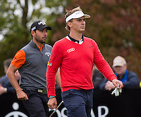 18.10.2014. The London Golf Club, Ash, England. The Volvo World Match Play Golf Championship.  Day 4 quarter final matches.  Joost Luiten [NED] and Pablo Larrazabal [ESP] on the ninth tee.