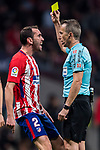 Diego Roberto Godin Leal (l) of Atletico de Madrid argues with referee David Fernandez Borbalan as he is shown the yellow card during the La Liga 2017-18 match between Atletico de Madrid and Real Madrid at Wanda Metropolitano  on November 18 2017 in Madrid, Spain. Photo by Diego Gonzalez / Power Sport Images