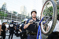 Police use bicycles to move crowds of protesters at the New York Public Library in New York City on August 31, 2004 during the Republican National Convention.  The library steps were a meeting point for a group calling itself the A31 Action Coalition which called for civil disobedience on a mass scale that day.  The library steps quickly cleared as police began arresting people, sometimes indiscriminately.