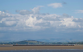 Clouds over the Lake District seen from  Arnside, Lancashire, UK.  Features the long railway bridge across the sands of the river Kent.