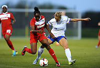Boyds MD - April 19, 2014: Robyn Gayle (5) of the Washington Spirit goes against Merritt Mathias (9) of FC Kansas City. The Washington Spirit defeated the FC Kansas City 3-1 during a regular game of the 2014 season of the National Women's Soccer League at the Maryland SoccerPlex.