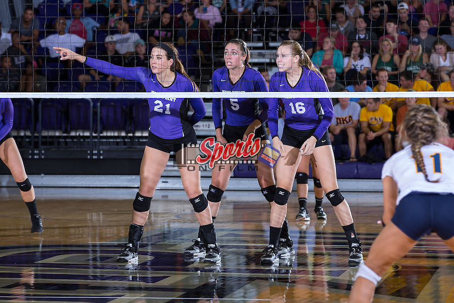 Camryn Freiberg (21), Kristin Heldt (5) and Chelsea Davis (16) during the match against the UNC Greensboro Spartans at Millis Athletic Center on September 16, 2014 in High Point, North Carolina.  The Panthers defeated the Spartans 3-0.   (Brian Westerholt/Sports On Film)