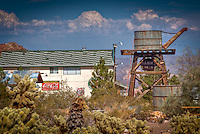 Nelson Nevada, about 25 miles southwest of Las Vegas was once an active mining area which produced millions of dollars in gold, silver, copper and lead.  Over the last decade owners of the mine have restored a number of buildings and created a museum to the area and the Techatticup Mine. There are several building, old vehicles and just about anything else lying around that they have collected.