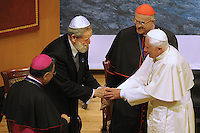 Pope Benedict XVI, right, shakes hands with Rabbi Shear Yashuv Cohen during an interfaith gathering at the Notre Dame Center in Jerusalem, Monday, May 11, 2009.