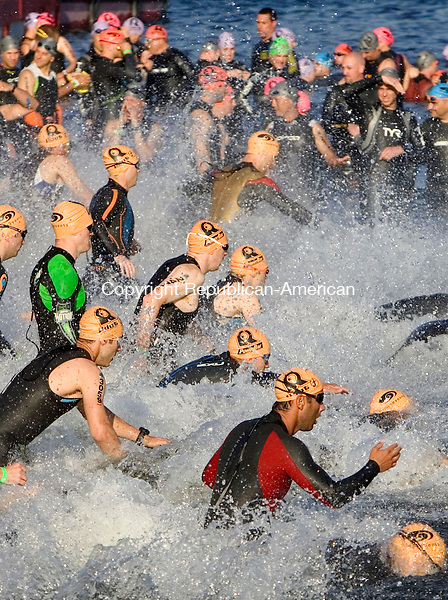 MIDDLEBURY CT. 02 June 2013-060213SV04-Athletes take off into the water during the REV3 Triathlon at Quassy in Middlebury Sunday.<br /> Steven Valenti Republican-American
