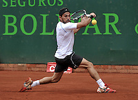BOGOTA - COLOMBIA -09 -11-2013: Victor Estrella, tenista de Republica Dominicana, devuelve la bola a Guilherme Clezar, tenista de Brasil, durante partido de semifinales del Seguros Bolivar Open en el Club Campestre el Rancho de la ciudad de Bogota. / Victor Estrella, Republica Dominicana tennis player returns player returns the ball to Guilherme Clezar, Brazil tennis player during a match for the semifinals of the Seguros Bolivar Open in the Club Campestre El Rancho in Bogota city. Photo: VizzorImage  / Luis Ramirez / Staff.