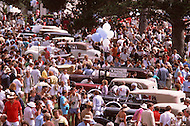 August 26th, 1984. Crowd of classic old car amateurs gathering and looking at the various models of the Concours.