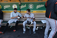 OAKLAND, CA - JULY 20:  Hunter Pence #8 and Steven Duggar #6 of the San Francisco Giants get ready in the dugout before the game against the Oakland Athletics at the Oakland Coliseum on Friday, July 20, 2018 in Oakland, California. (Photo by Brad Mangin)
