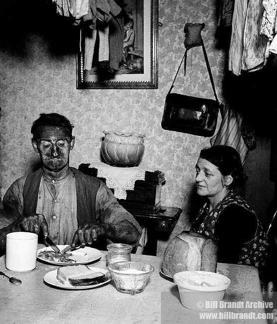 Miner at his evening meal 1937