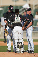 Kannapolis pitching coach Larry Owens has a chat with pitcher Jake Rasner and catcher Francisco Hernandez in a game versus asheville at Fieldcrest Cannon Stadium in Kannapolis, NC, Sunday, April 29, 2007.