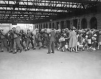 A scene at a London railway station showing troops arriving while kiddies who are being evacuated from London leave for the reception area.  Ca. 1940.   New Times Paris Bureau Collection.  (USIA)<br /> Exact Date Shot Unknown<br /> NARA FILE #:  306-NT-3170V<br /> WAR &amp; CONFLICT BOOK #:  1013