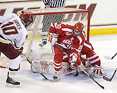 Jimmy Hayes (BC - 10), Corey Trivino (BU - 10), Kieran Millan (BU - 31) - The Boston College Eagles defeated the visiting Boston University Terriers 5-2 on Saturday, December 4, 2010, at Conte Forum in Chestnut Hill, Massachusetts.