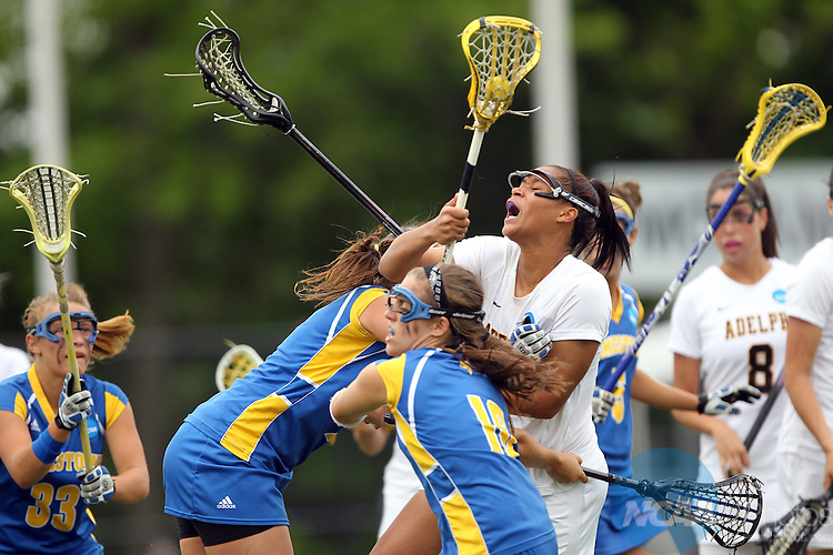 22 MAY 2011:  Demmianne Cook (27) of Adelphi University is crushed by Limestone's Skylar Marcoux (16) during the Division II Women's Lacrosse Championship held at Motamed Field on the Adelphi University campus in Garden City, NY. Adelphi University defeated Limestone College 17-4 to win their national title.  John Munson/ NCAA Photos