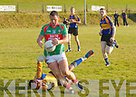 St Michaels Foilmore Johnny Clifford powers past the Kenmare Keeper Stephen O'Sullivan and leaves himself with an easy tap in for a goal in their Saturday night clash which finished in a draw after extra time St Michaels/Foilmore 1-12 Kenmare District 0-15.