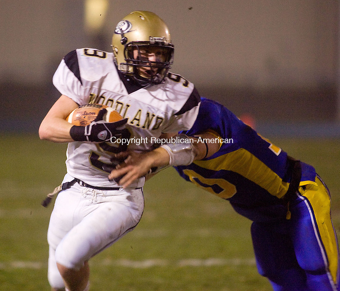 SEYMOUR, CT - 25 NOVEMBER 2009 -112509JT16--<br /> Woodland's Chris D'Occhio avoids a tackle from Seymour's Connor Shugrue during Wednesday's game at Seymour. The Hawks won, 55-32.<br /> Josalee Thrift Republican-American