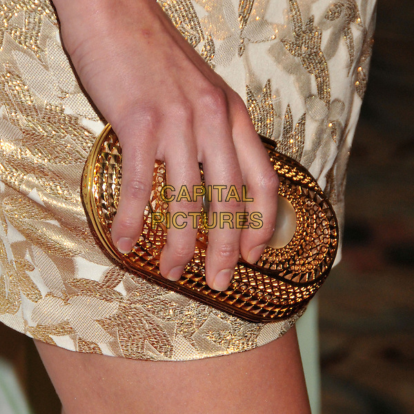 YVONNE STRAHOVSKI .NBC Universal's TCA Press Tour Party 2009 held at the Langham Huntington Hotel & Spa, Pasadena, CA, USA, .5th August 2009..detail hand gold clutch bag.CAP/ADM/BP.©Byron Purvis/Admedia/Capital Pictures
