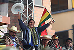 Native Bolivian senator Leonida Zurita waves to crowd while attending the ceremony of the New Constitution of Bolivia signed by President Evo Morales at El Alto, in the surroundings of La Paz, February 7, 2009. The new Constitution marks a new relationship between the Indian people, their communal justice, regional autonomy, and respecting their cultures. Photo by Heriberto Rodriguez