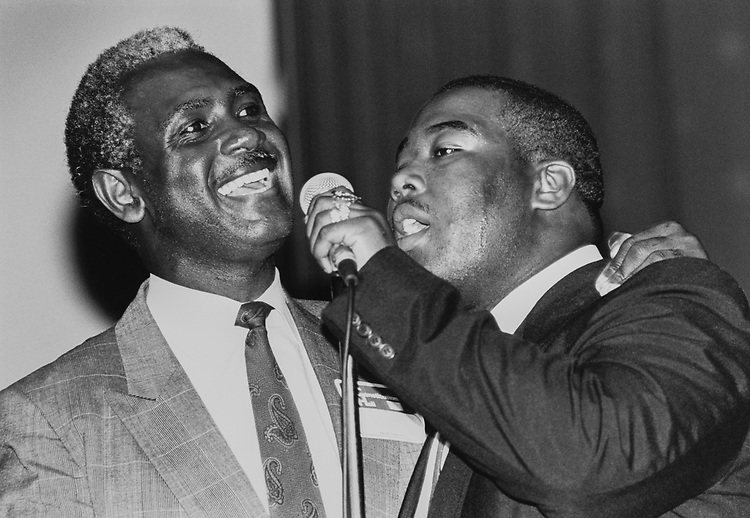 Lead Singer Harvey Gantt and Kenneth Page in a Gospel Group from Winston Salem, North Carolina singing gospel music at a fundraiser for Gantt at DAR Constitution Hall on Sep. 13, 1990. (Photo by Laura Patterson/CQ Roll Call via Getty Images)