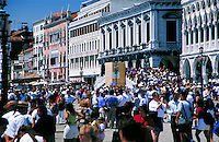 The tourists crowd the streets of Venice, Italy. street scene, tourism. Venice, Italy.